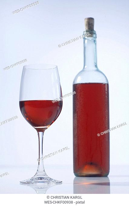 Rose wine bottle and glass of rose wine