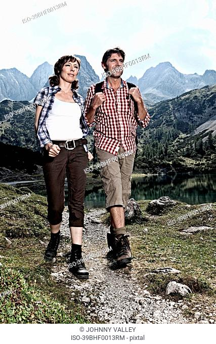 Couple hiking in rocky mountains