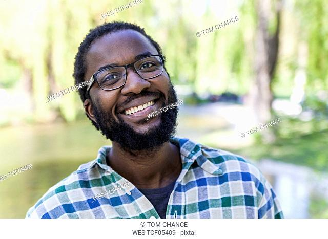 Portrait of smiling man with beard and glasses