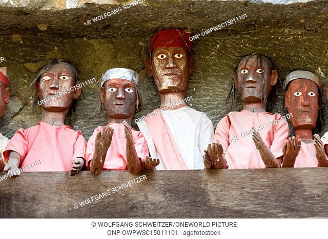 Indonesia, Sulawesi Selatan, Tana Toraja, Torajaland, Human wooden figures, Dew are carved wooden figures, rock tombs, death cult