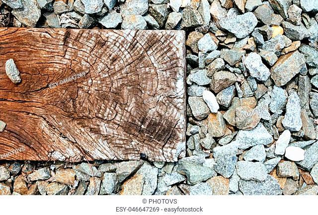 old wooden sleeper on railway, railroad sleepers stones