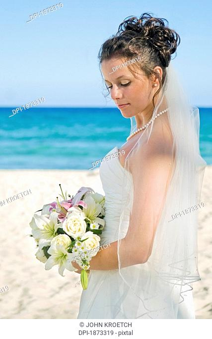 mayan riviera, akumal, mexico, bride on the beach at gran bahia principe tulum all-inclusive resort