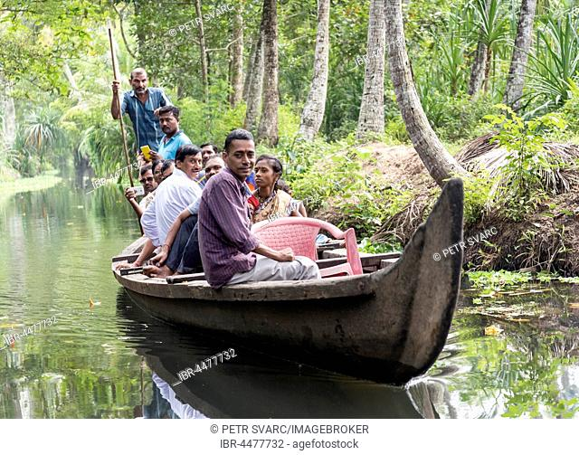 Group of Indian Tourists on a boat, Kerala Backwaters, India