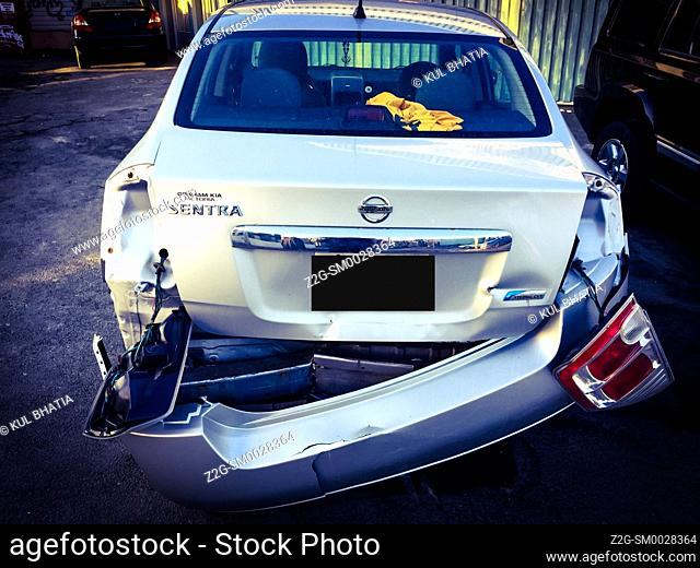 A damaged car at an Auto Body Shop, presumably after an accident, Canada
