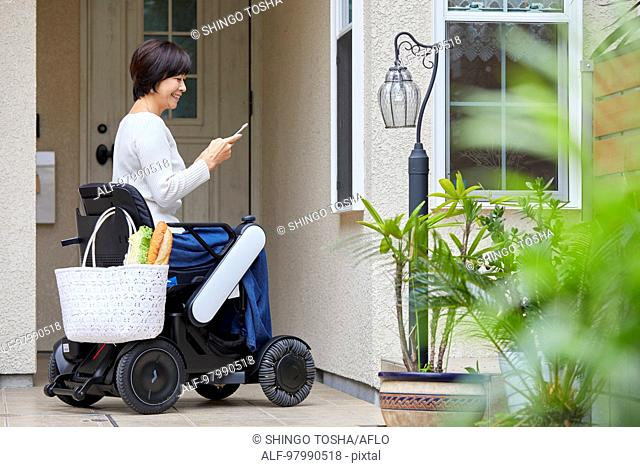 Japanese senior woman on electric wheelchair