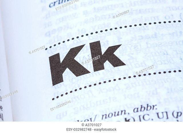 closeup letter K in dictionary, soft focus