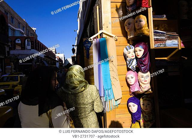 Arab women walk past a hijabs shop at the Via Recta street in Damascus, Syria