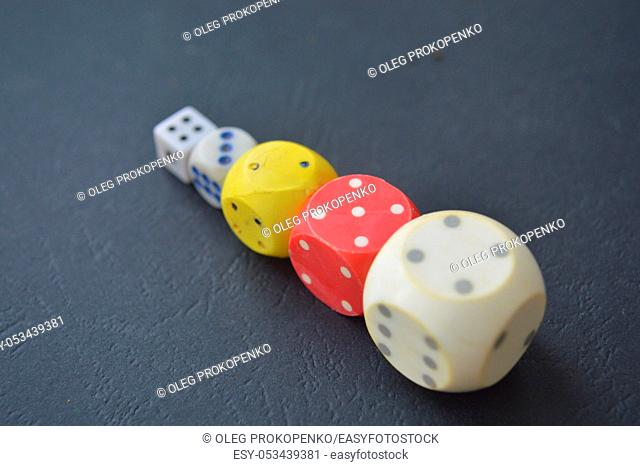 Game dice in the composition of different cubes on background