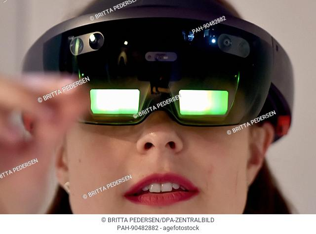 A young woman looks through a Microsoft hololens at the labore:tory at the internet conference re:publica in Berlin, Germany, 8 May 2017