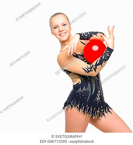 Gymnast girl in beautiful costume making jumping exercise with red ball. Isolated over white background. Copy space