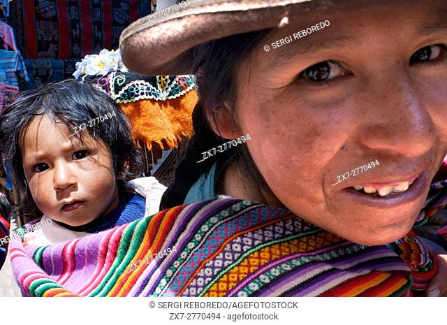 Sacred Valley, Pisac, Peru. A woman dressed in a traditional costume in Pisac Sunday market day. Pisac. Sacred Valley. Pisac, or Pisaq in Quechua
