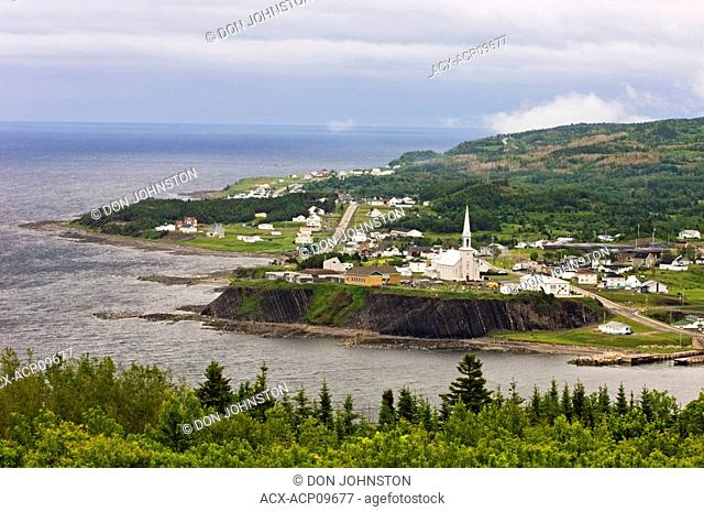 Church and town buildings along coastline of Gulf of Saint Lawrence, Gaspe Peninsula, Grand Vallee, Quebec, Canada