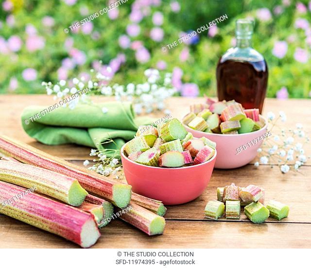 Rhubarb stalks and bowls of sliced rhubarb
