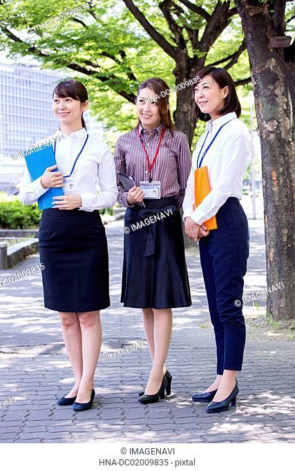 Business women having a file