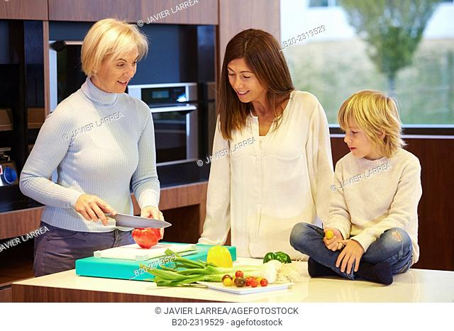 Family in the kitchen. Three generations. Healthy eating. Healthy growth. Vegetables