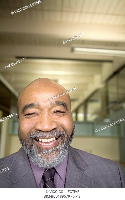 Laughing African businessman