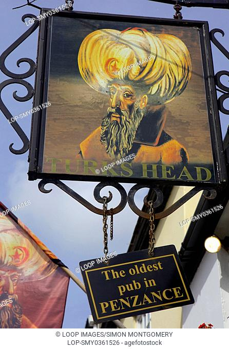 Pub sign of The Turks Head which is the oldest pub in Penzance