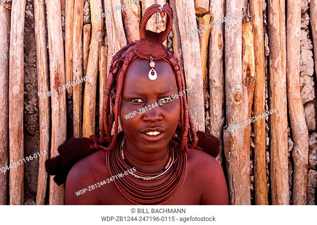 Namibia Africa remote nomadic Himba tribe young women with braids and traditional dress in desert of Hartmann Berge in Namib Desert