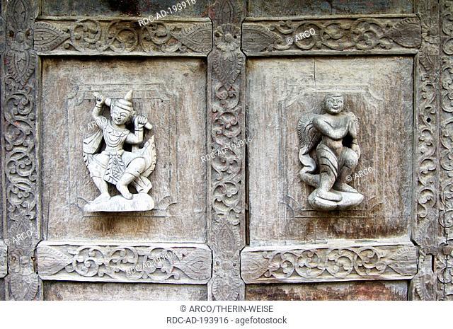 Carved teak figures, Monastery Shwe In Bin Kyaung, Mandalay, Burma, Myanmar