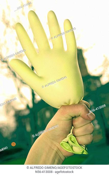 Hand holding glove