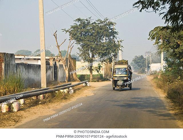 Auto rickshaw on the road, Sohna, Gurgaon, Haryana, India