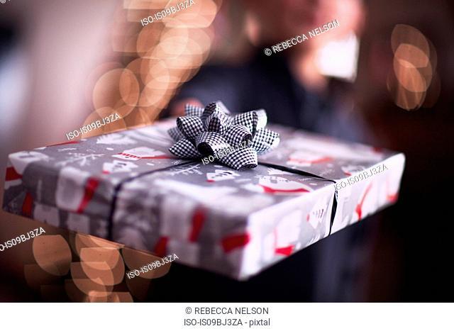 Boy handing over Christmas gift