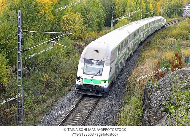 Salo, Finland - October 6, 2018: VR Group Passenger train at speed in autumn, elevated view from bridge