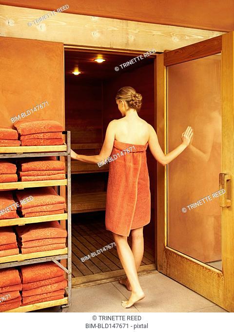 Caucasian woman entering sauna