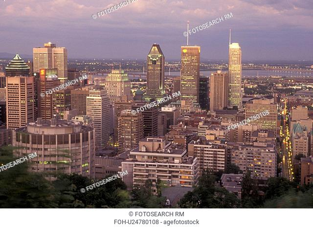 Canada, Quebec, Montreal, Aerial of the downtown skyline of Montreal from Mount Royal illuminated in the evening