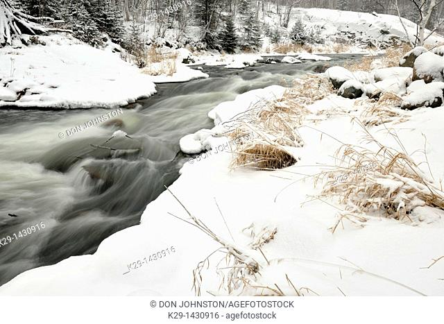 Junction Creek rapids with fresh snow in early winter Greater Sudbury Ontario