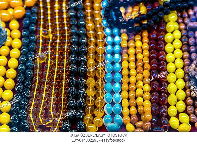 Collection of traditional colorful beads chain or rosary on display for sale in Grand Bazaar Istanbul, Turkey
