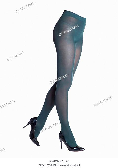 Legs of beautiful girl in dark blue tights. Isolated on white background