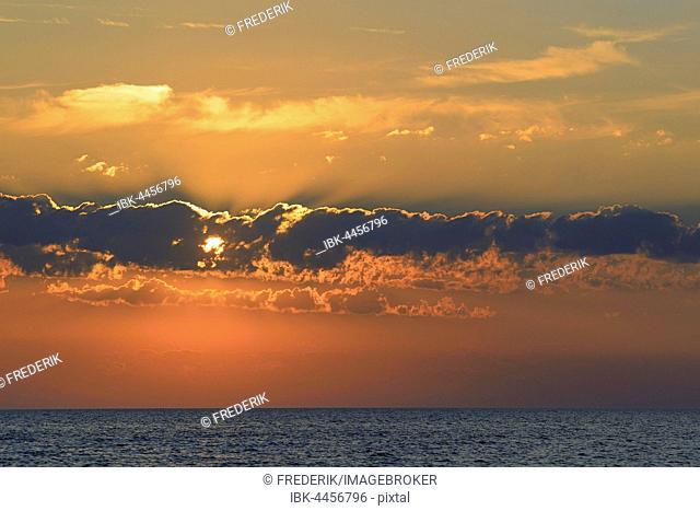 Sunset with clouds above North Sea, St. Peter-Ording, Schleswig-Holstein Wadden Sea National Park, North Frisia, Schleswig-Holstein, Germany