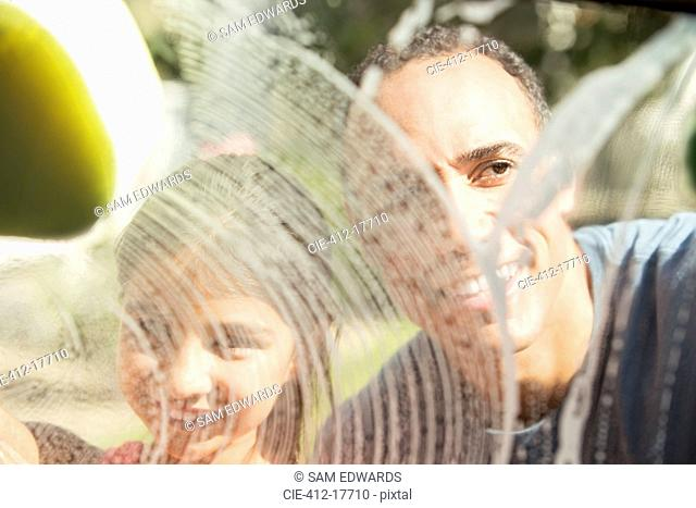Father and son washing window