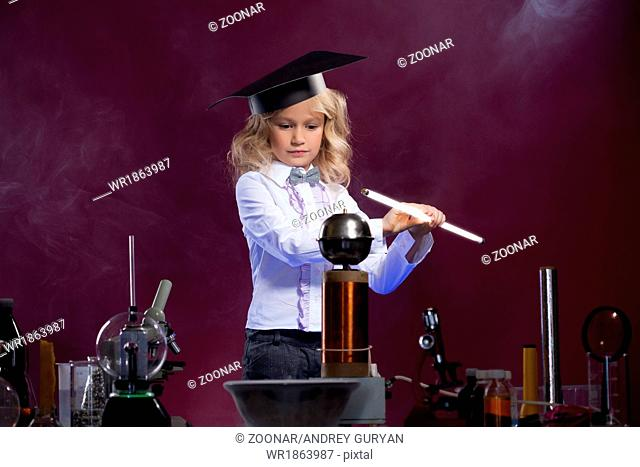 Cute little scientist posing in physics laboratory