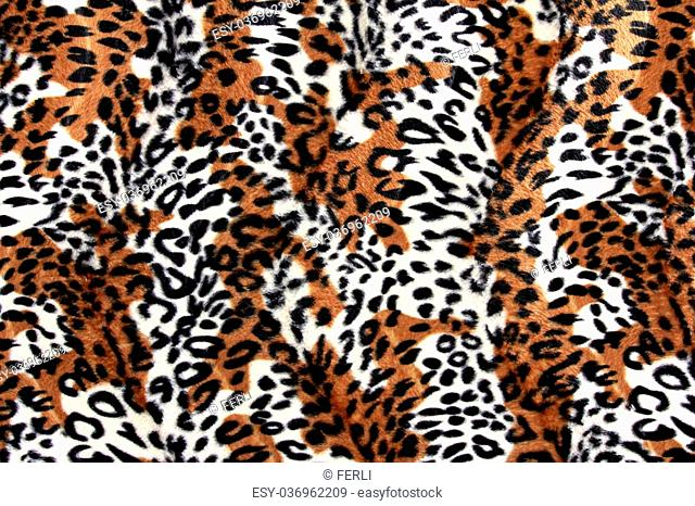close up of beautiful tiger fur - colorful texture with orange, beige, and black