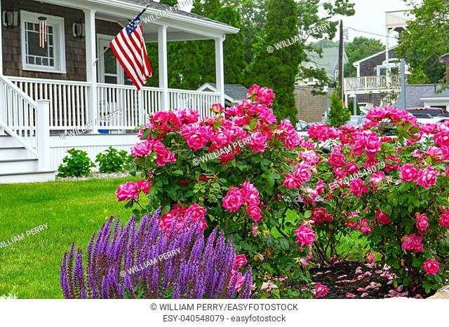 US Flag House Colorful Flowers Padnaram Village Dartmouth Masschusetts . .