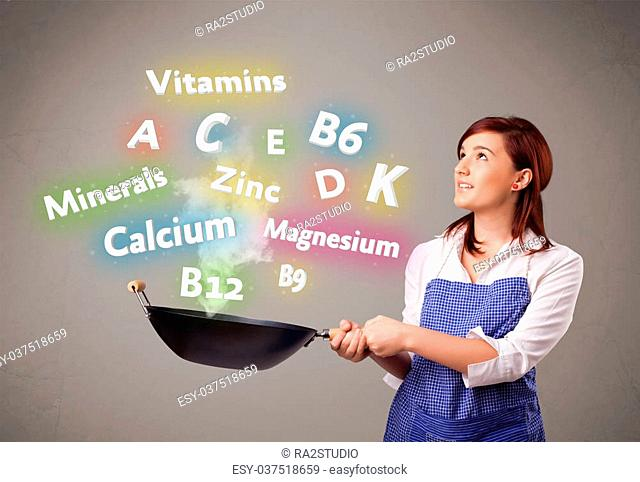Pretty young woman cooking vitamins and minerals
