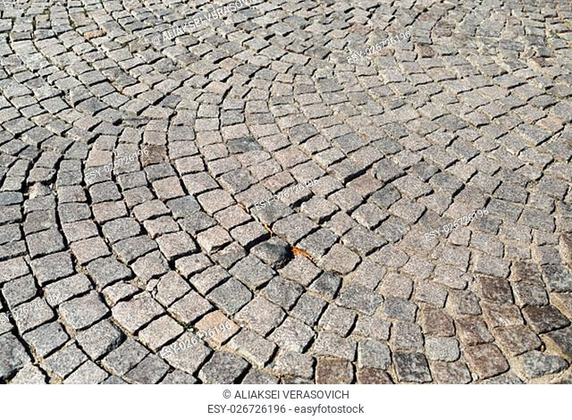 Abstract structured background. Stone paving texture. Vintage old cobblestone pavement