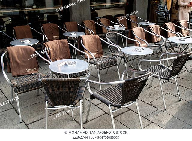 Empty seats outside cafe Karl Johan street Oslo Norway