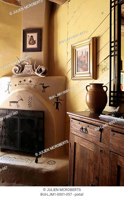 Kiva fireplace and cabinet