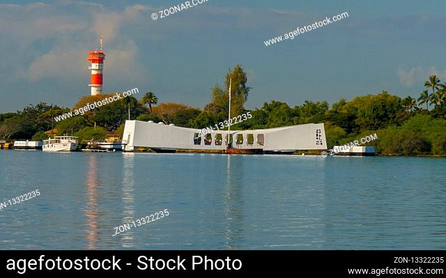 PEARL HARBOR, UNITED STATES OF AMERICA - JANUARY 12 2015: early morning reflections of the arizona memorial at pearl harbor, hawaii