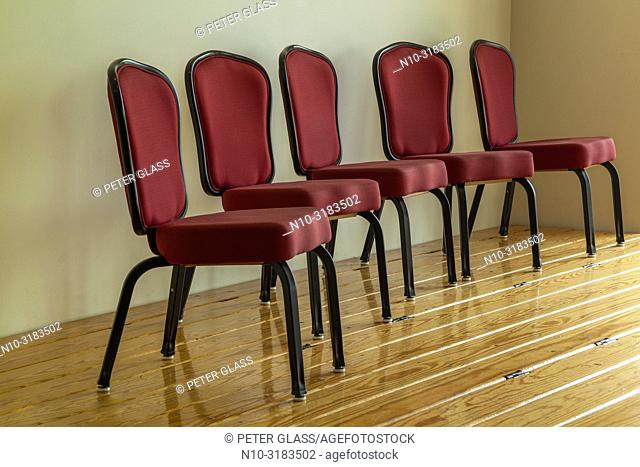 Chairs on a small wooden stage