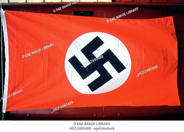 Nazi flag, North Yorkshire Moors Railway Wartime Weekend, Levisham Station, North Yorkshire. The North Yorkshire Moors Railway's Wartime Weekend is a...