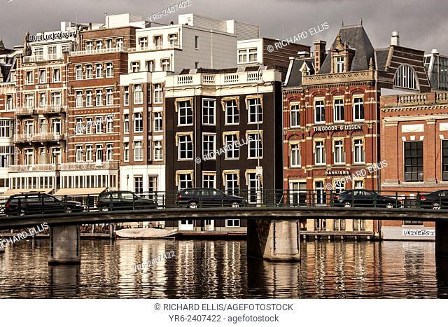 The Amstel River and Halvemaansbrug bridge in Amsterdam