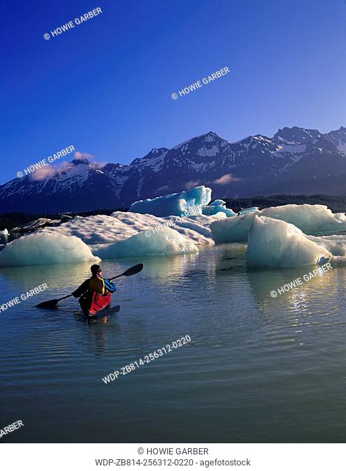 Kayaker Jonathon in awe of icebergs on Alsek Lake, Glacier Bay National Park & Preserve, Alaska