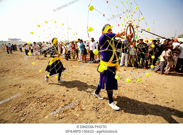 Young Nihangs or Sikh warriors performing a traditional martial art called Gatka during the cultural events held for celebrations of 300th year of consecration...