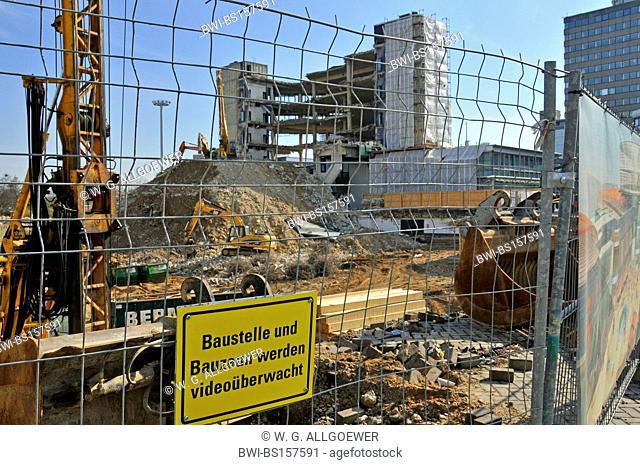 construction side of new buying centre (Rathaus-Galerie) with information sign: Baustelle und Bauzaun werden Viedeoueberwacht, Germany, North Rhine-Westphalia