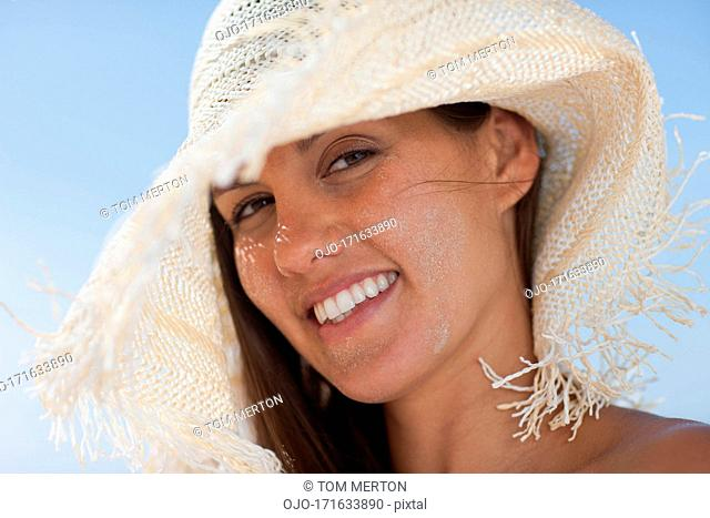 Close up of woman in sun hat