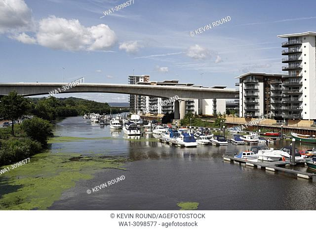 Boats moored in the Ely River in Cardiff Bay, Wales UK